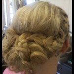 Special Occasion Up-Do - Bridesmaid braiding back. Stylist: Hope